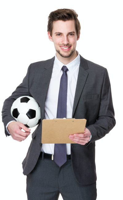Football manager hold with a soccer and clipboard